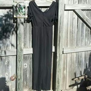 Black jumpsuit short sleeve keyhole midrif size sm